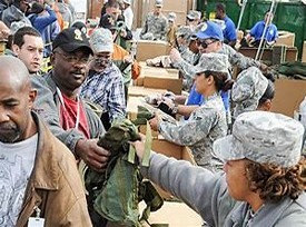 SOldiers passing out clothing and food at a Stand Down